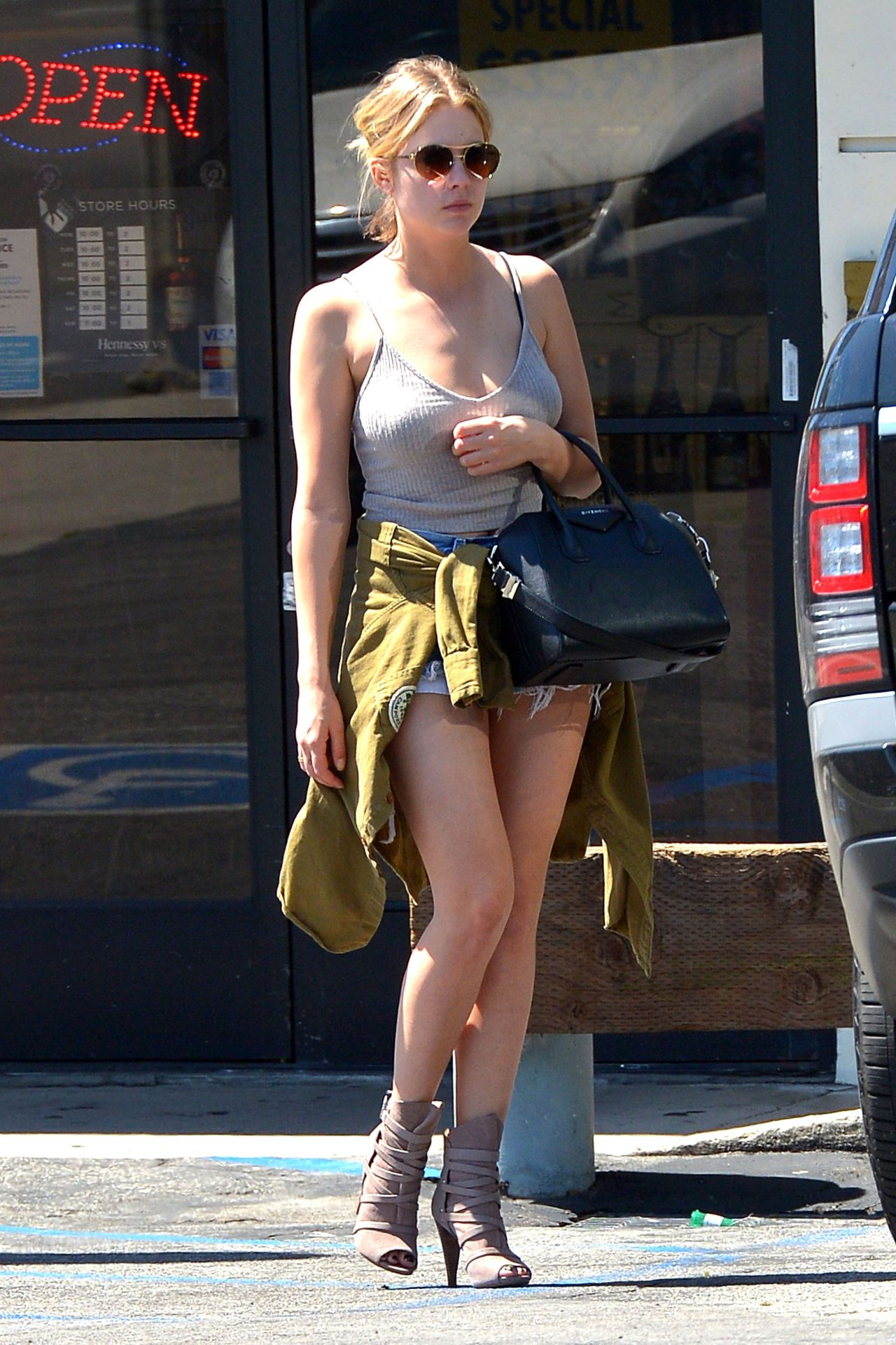 Ashley Benson Shows Off Her Legs in Jeans Shorts - at a Liquor Store in LA, March 2015