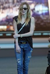 Katie Cassidy in Ripped Jeans at Vancouver International Airport, March 2015
