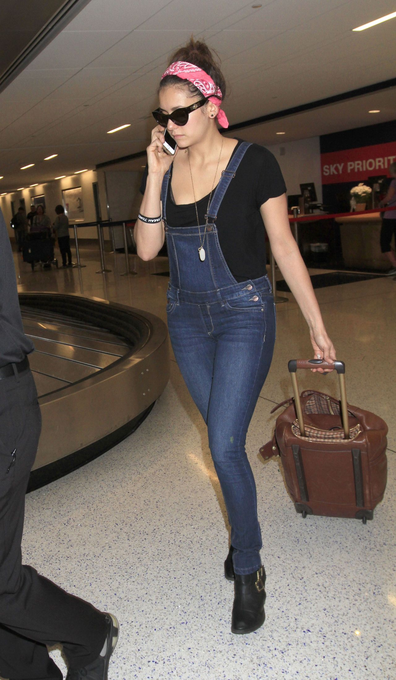 Nina Dobrev Street Style - at LAX Airport in Los Angeles - March 2015