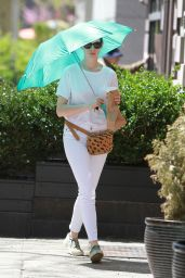 Anne Hathaway Spotted Using a Large Tturquoise Umbrella - New York City, April 2015