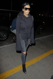 Kim Kardashian - Arrives at Los Angeles International Airport, April 2015