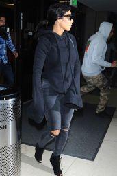 Kim Kardashian - Arrives at Los Angeles International Airport, April 2015
