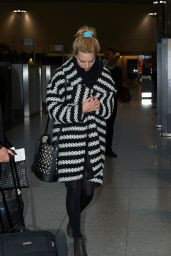 Margot Robbie at Heathrow Airport in London, April 2015