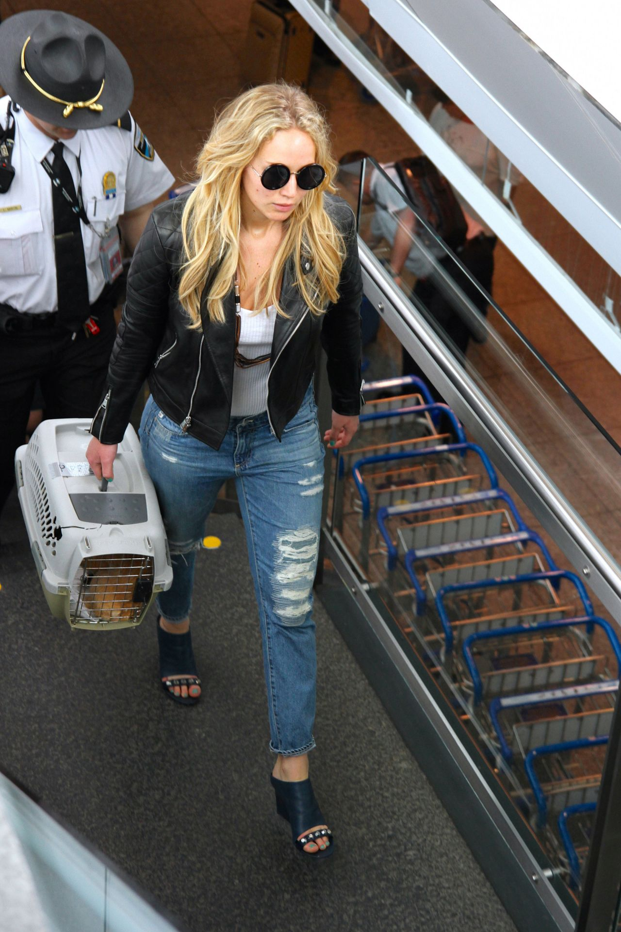 a96ac5c71a4 Jennifer Lawrence in Ripped Jeans at Trudeau International Airport in  Montreal, May 2015