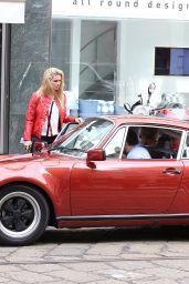 Michelle Hunziker & Tomaso Trussardi Drive Their Porsche in Milan, May 2015