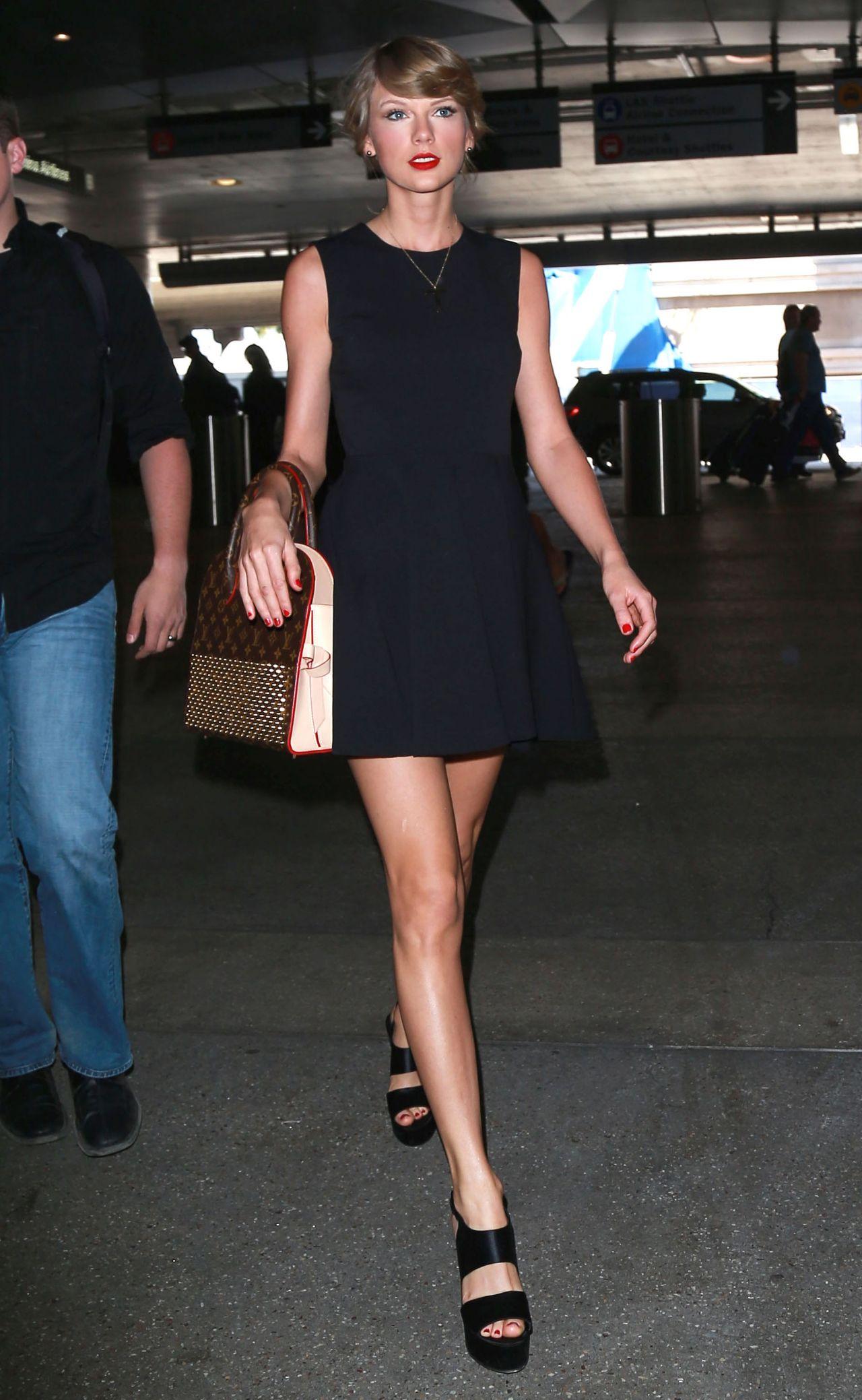 Taylor Swift in Black Mini Dress - LAX Airport, May 2015