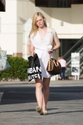 Elle Fanning Leaving Urban Outfiters in LA , June 2015