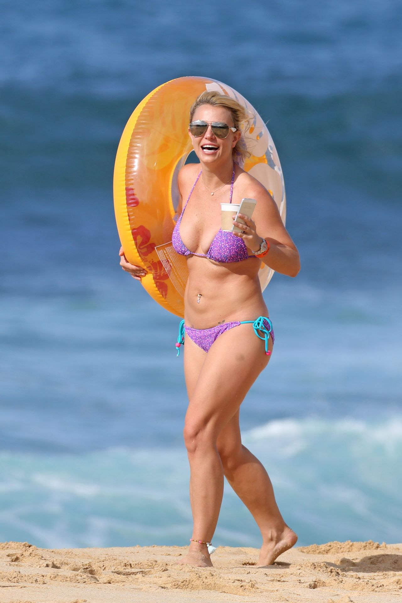 With her slim body and Light blond hairtype without bra (cup size 36B) on the beach in bikini