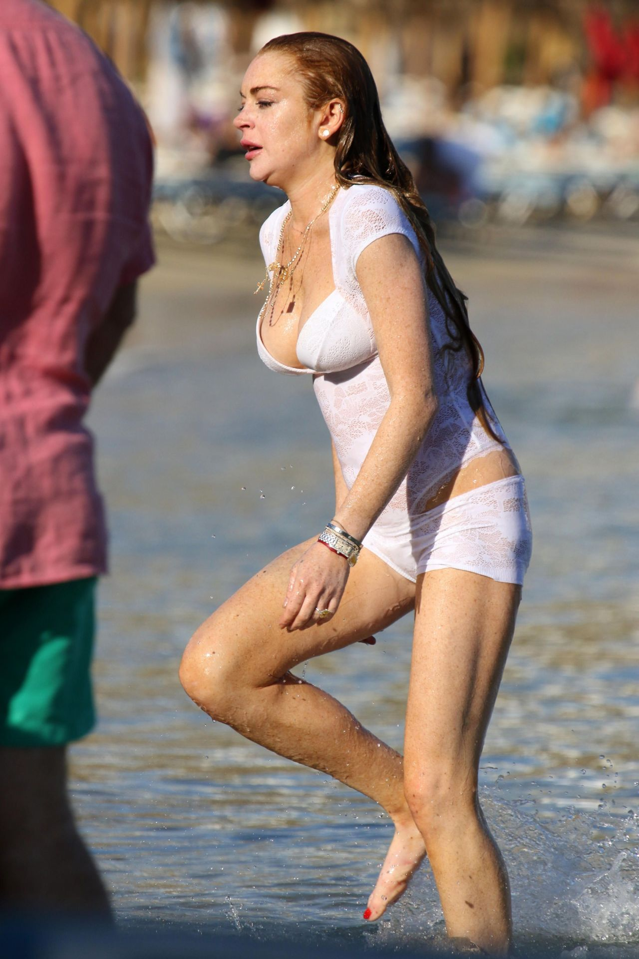 lindsay lohan swim at a beach in mykonos july