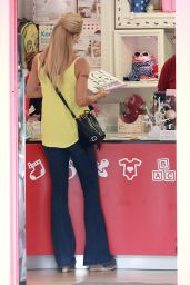 Michelle Hunziker - Sole and Tomaso Trussardi shopping at Salina Baby Shop in Milan