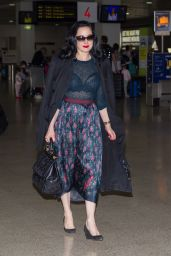 Dita Von Teese - Wearing Blue Top, Blue Skirt and a Large Black Coat - Melbourne Airport