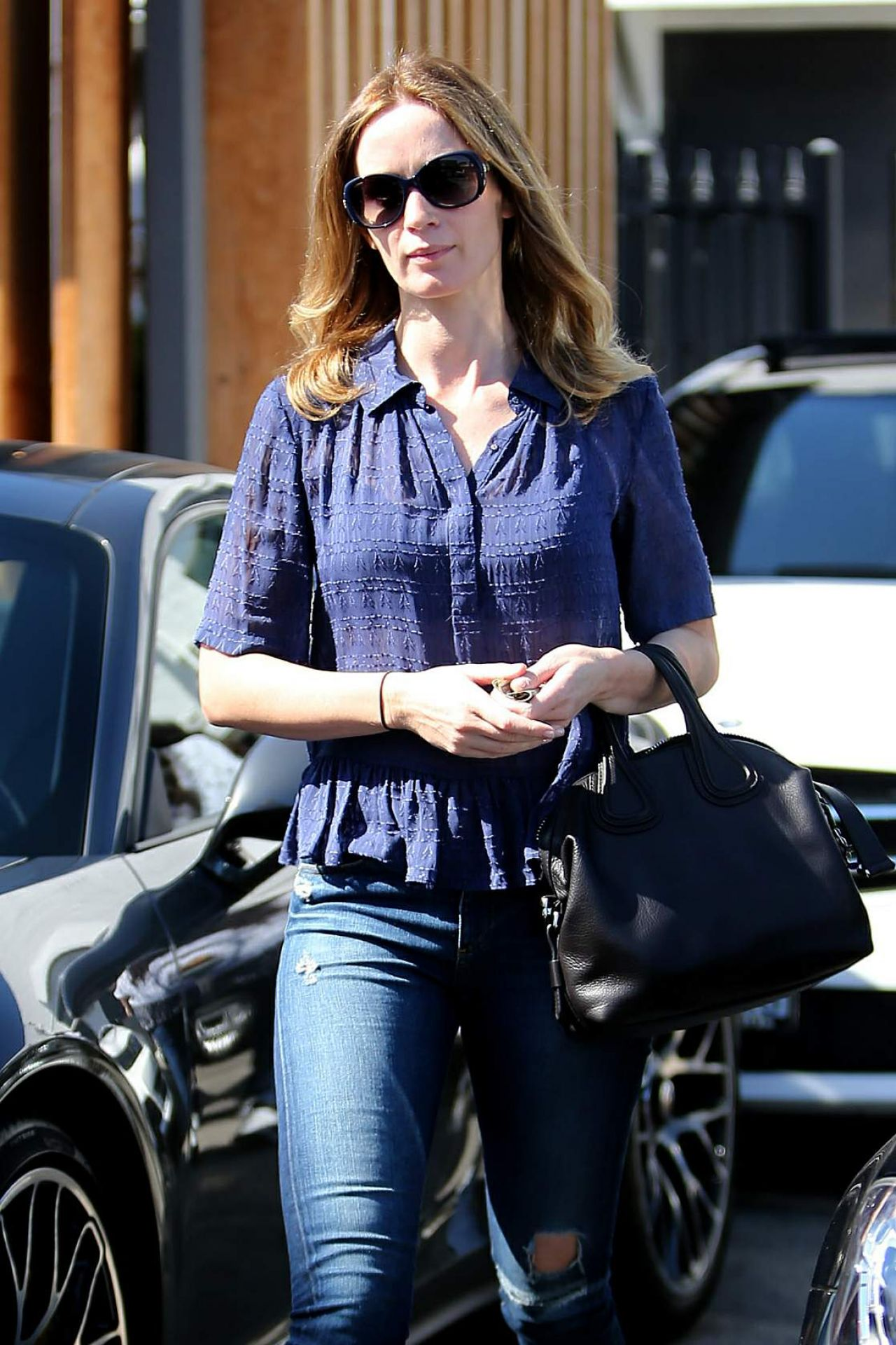 Emily Blunt In Ripped Jeans