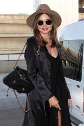 Miranda Kerr in Black Mini Dress at LAX Airport in Los Angeles, September 2015