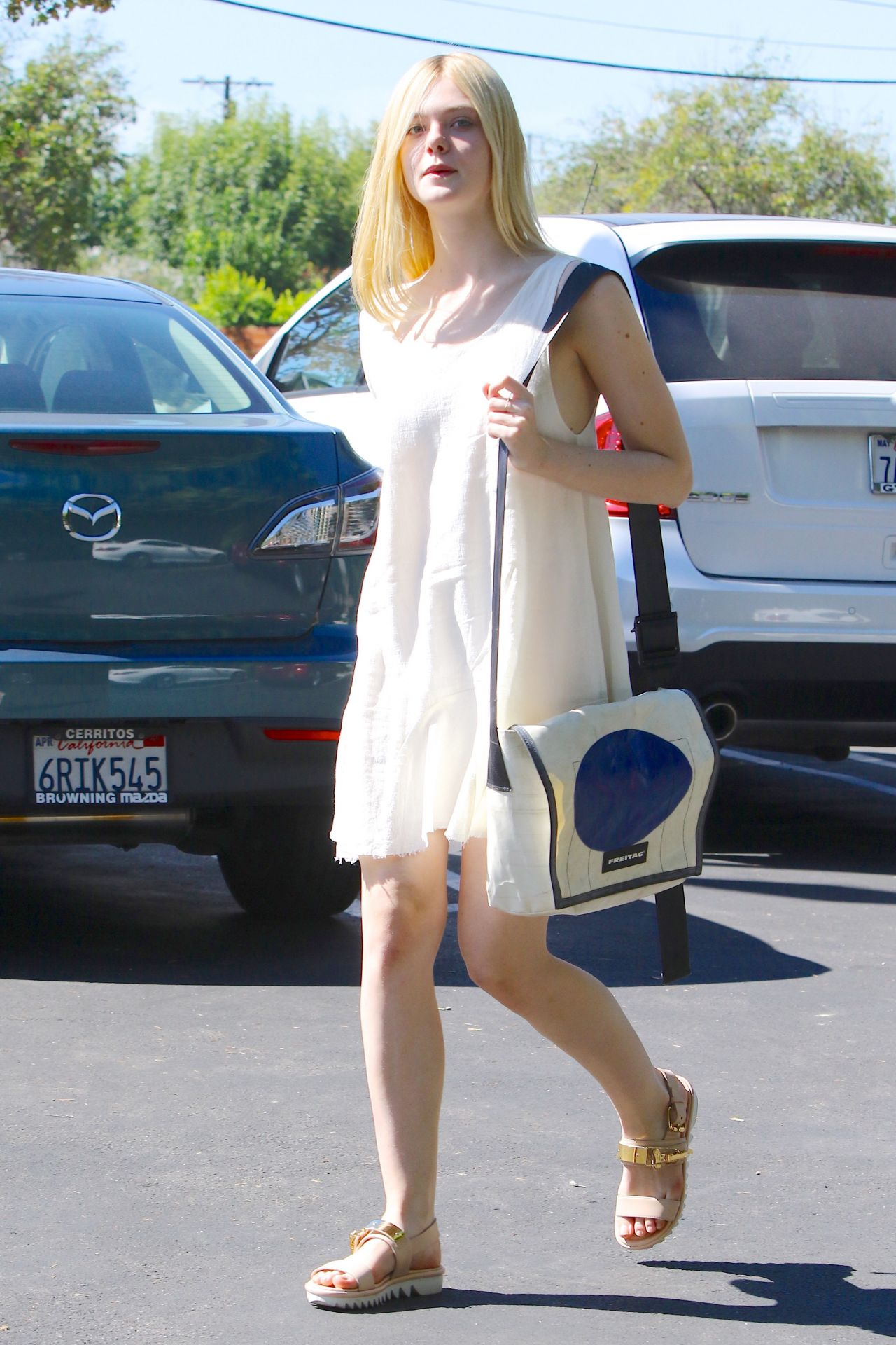 Elle Fanning In White Summer Dress Out In Hollywood