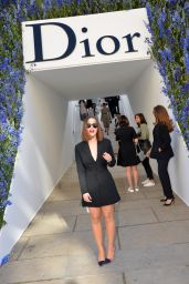 Emilia Clarke - Laving the Christian Dior Fashion Show at the Cour Carree du Louvre in Paris