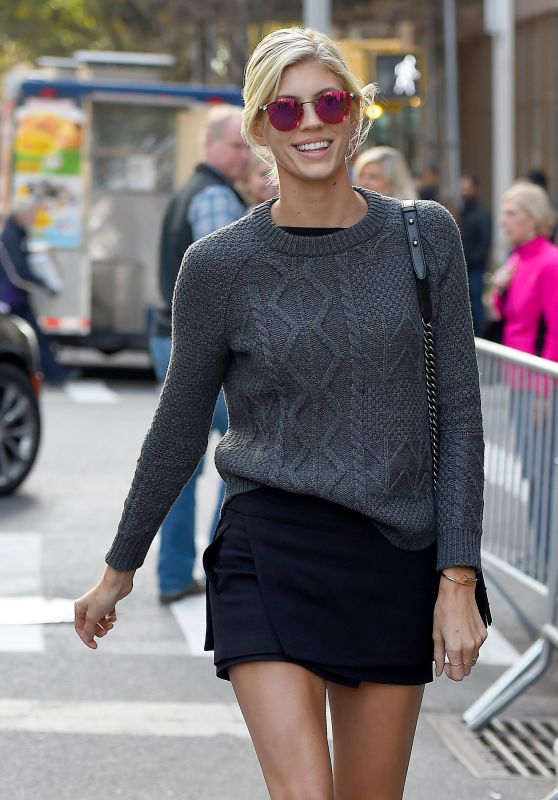 Devon Windsor Wearing a Grey Sweater and Black Skirt - Enters the Victoria