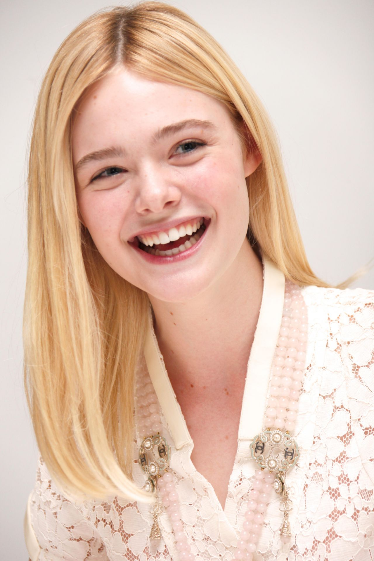 Elle Fanning Trumbo Press Conference In Los Angeles