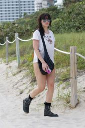 Daisy Lowe in aWhite Swimsuit on the Beach in Miami 12/30/2015