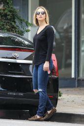 Jennifer Lawrence in Ripped Jeans - December 2015
