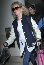 Kim Basinger in Her Varsity Jacket - Arrives at LAX in Los Angeles 12/21/2015