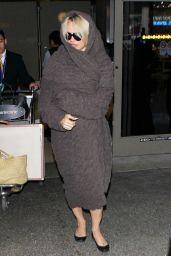 Pamela Anderson at LAX, 12/9/2015