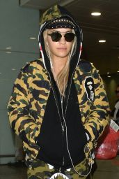 Rita Ora in Camouflage Tracksuit at Heathrow Airport in London 12/24/2015