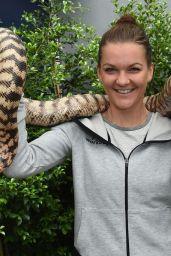 Agnieszka Radwanska Holding a Python Snake - Melbourne 1/21/2016
