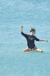 Cara Delevingne and Annie Clark Surf in Barbados 01/03/2016