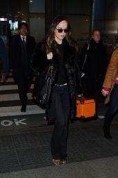 Dakota Johnson at Heathrow Airport in London 2/7/2016