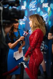 Jennifer Lopez Looks Red Hot in a Jumpsuit -