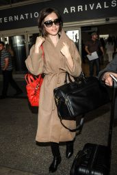 Lily Collins - Arrives at LAX in Los Angeles, February 2016