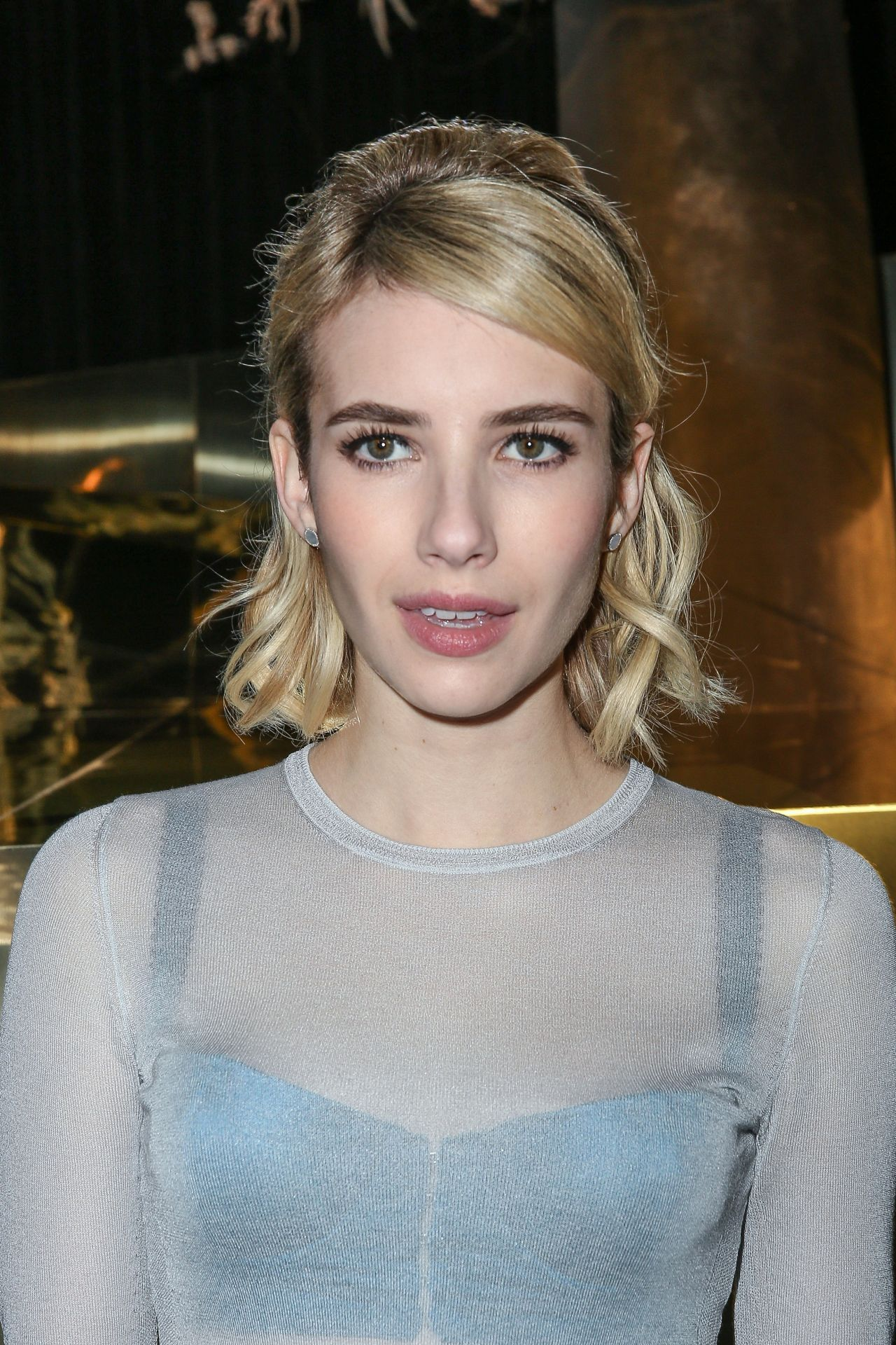 Emma Roberts Arriving at H&M Fashion Show
