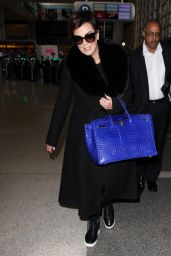 Kris Jenner is Ecstatic as she Catches a Flight to Paris at LAX in Los Angeles 3/2/2016