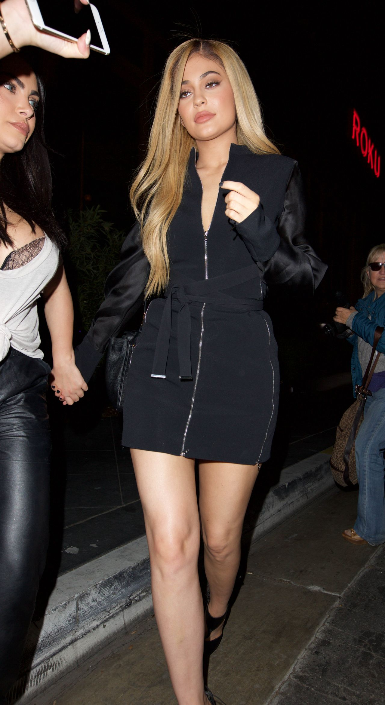 Kylie Jenner Shows Off Her Legs In Black Mini Dress Out
