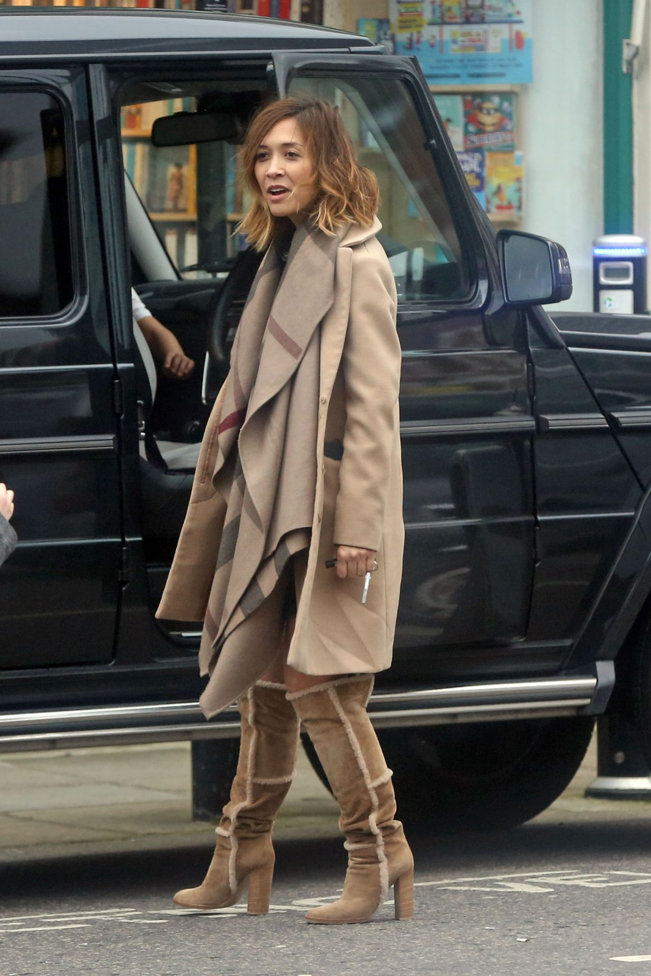 myleene klass highlights her toned legs in brown suede
