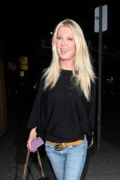 Tara Reid in Ripped Jeans at