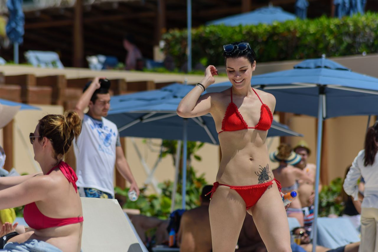 Jaimie alexander in a red bikini at the pool in cancun for European pool show