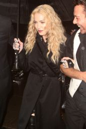 Madonna - Trying to Shield Herself From the Pouring Rain After Leaving the Met Gala in New York 5/2/2016