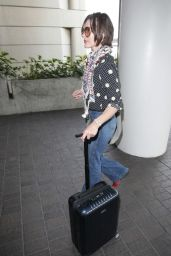 Milla Jovovich Travel Outfit - LAX Airport in Los Angeles 5/14/2016