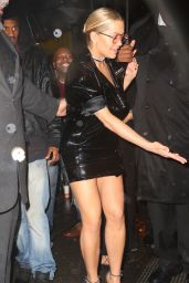 Rita Ora in a Low Cut Dress With
