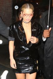 Rita Ora in a Low Cut Dress With