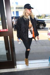 Rita Ora - Wore a Black Ball Cap With a Matching Jacket and Skinny Jeans - LAX in Los Angeles 5/29/2016