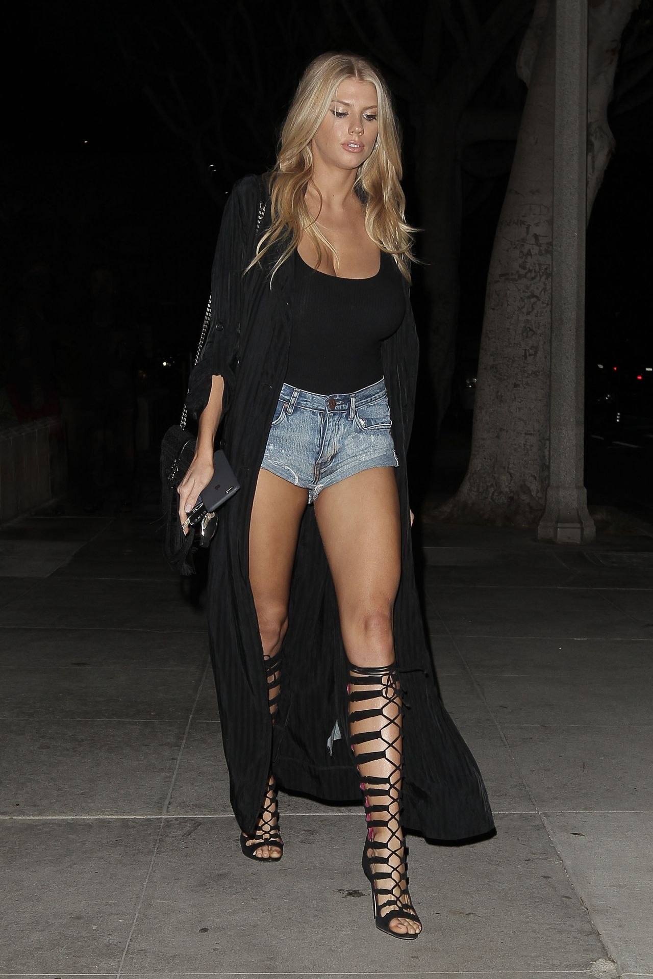 Charlotte Mckinney Shows Off Her Long Legs Leaves A