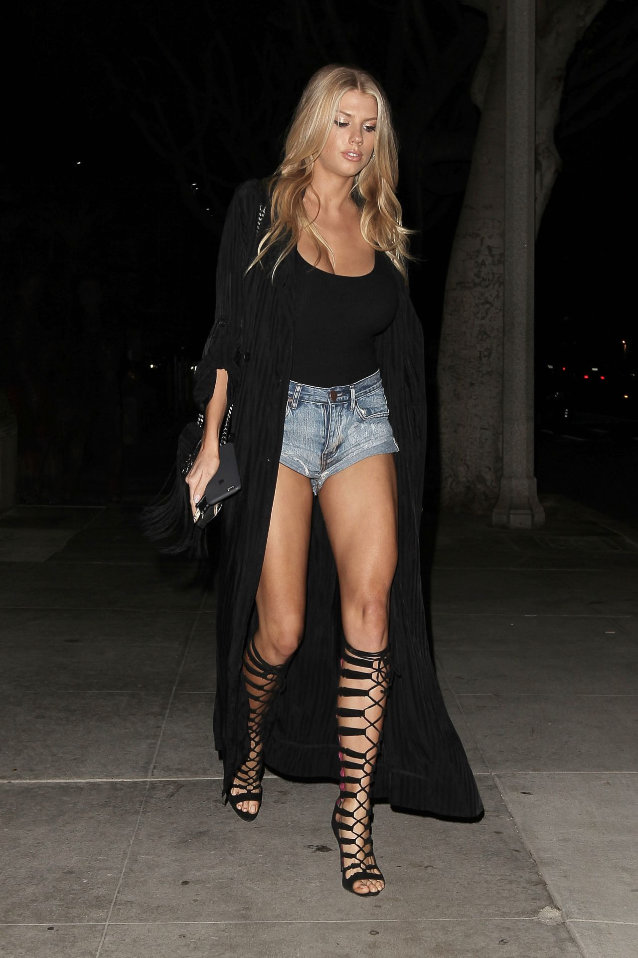 Charlotte Mckinney Shows Off Her Long Legs - Leaves A -9067