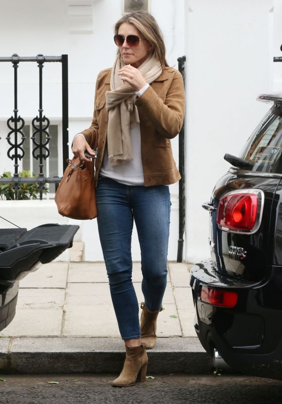 Elizabeth Hurley Travel Outfit - Arriving Home in London 6/1/2016