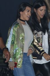 Kourtney Kardashian in a Satin Bomber Jacket, Neutral Tee, Ripped Jeans and Stilettos in Malibu 6/20/2016