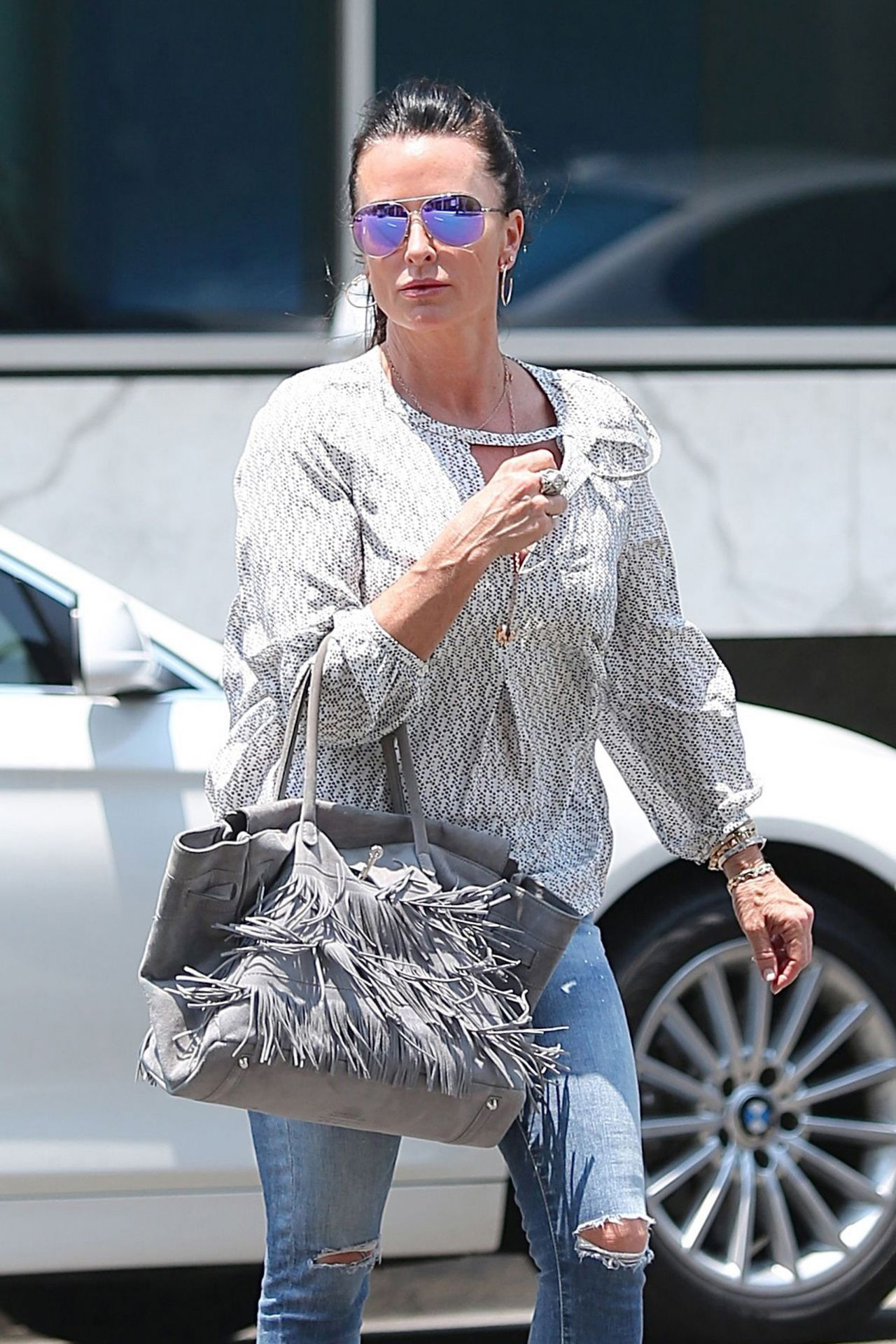 0b0715472e4 Kyle Richards in Ripped Jeans - Shopping in Beverly Hills 6 17 2016