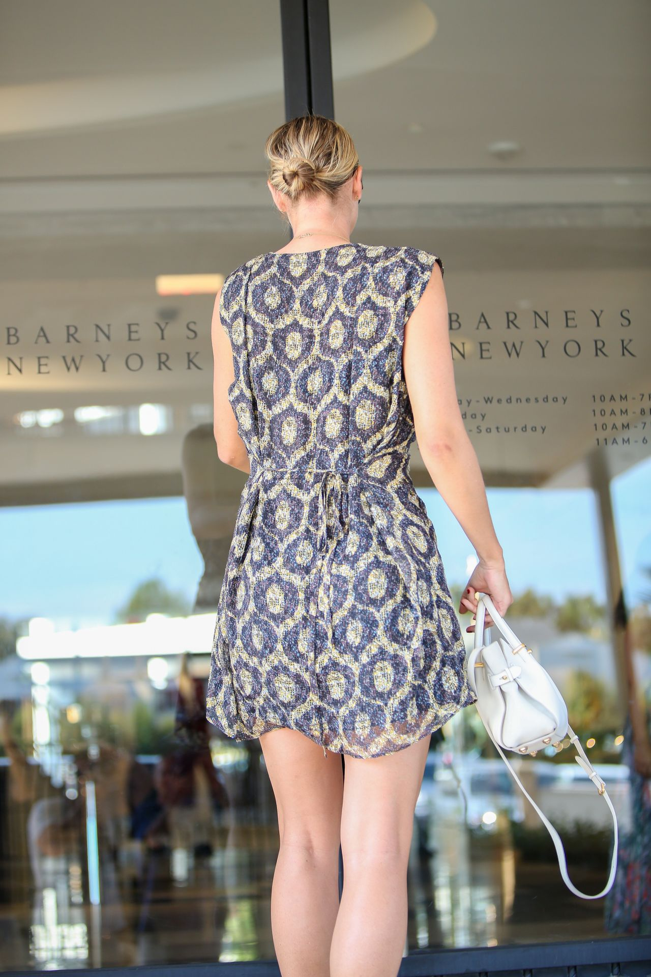 Maria Sharapova Shows Off Her Legs In Mini Dress Out In