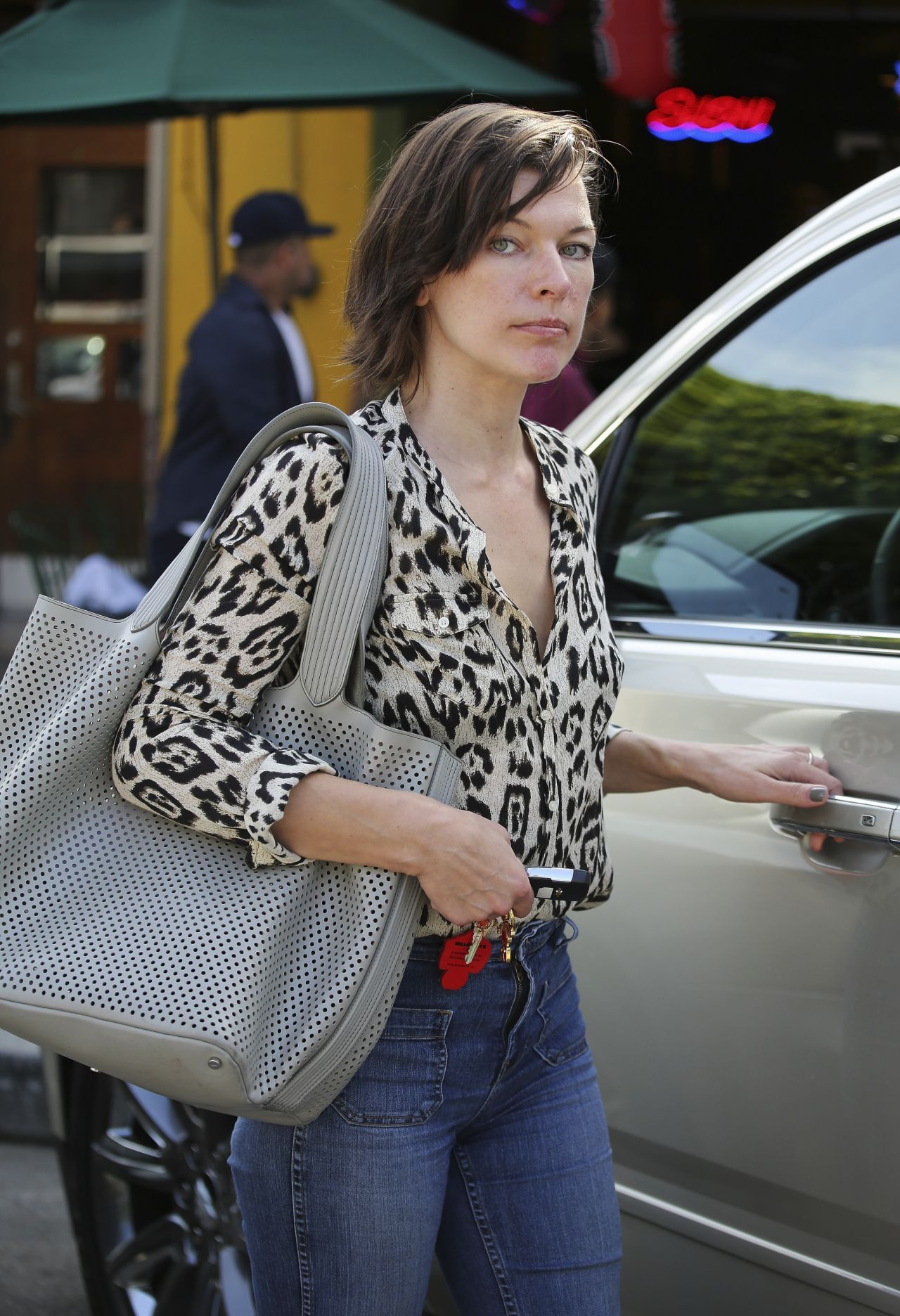 milla jovovich urban outfit strolling out in los angeles