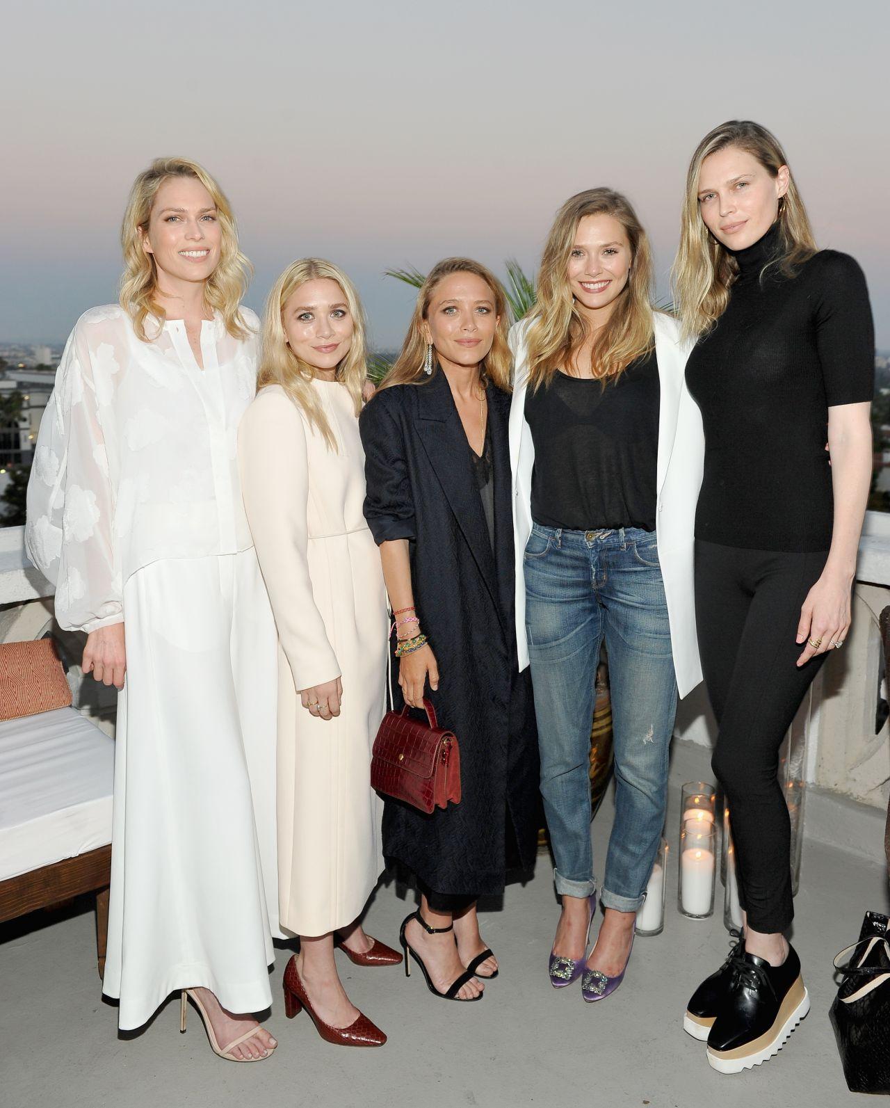 Elizabeth Olsen Growing Apart From Ashley & Mary-Kate Olsen |Elizabeth Olsen And Sisters 2014